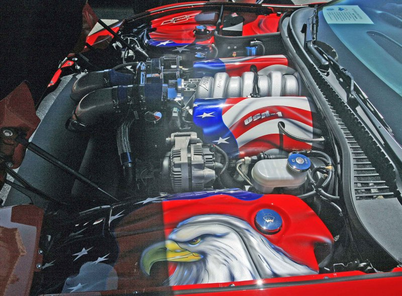 Wild Newer Vette With Patriot  Paint Job Under The Hood.