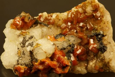 Red mimetite crystals to approximately 6 mm on quartz. Drygill, Caldbeck Fells.