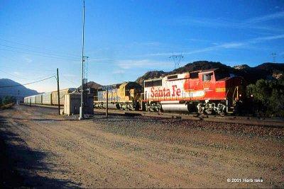 BNSF Red/Silver Warbonnet Heads Through Cajon XOs