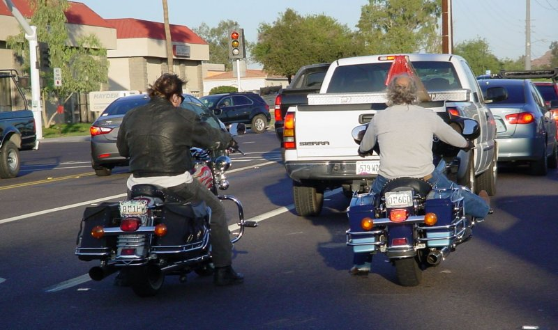 two bikers riding