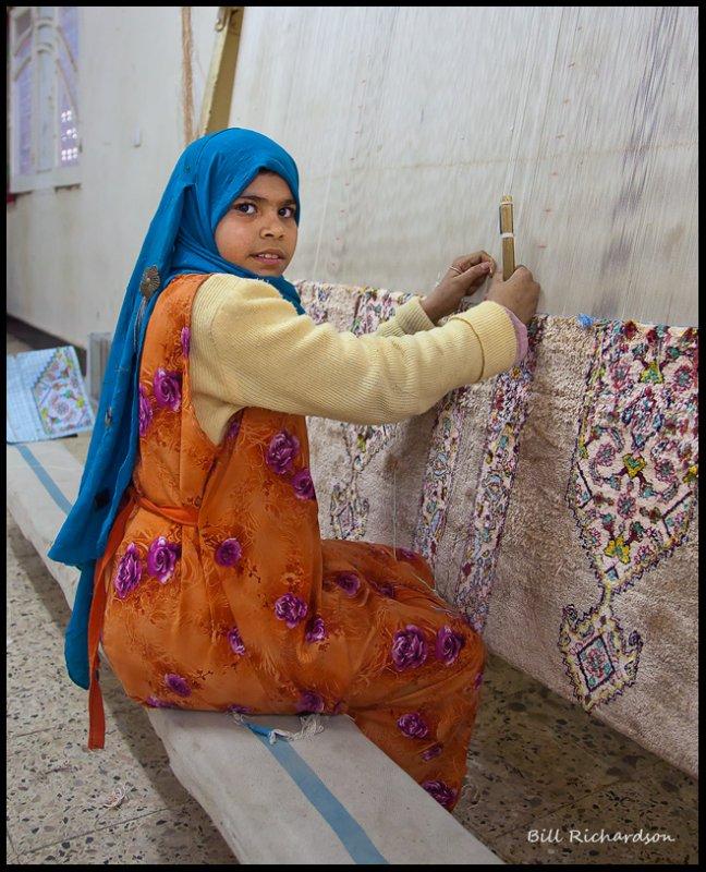 little girl weaving rug.jpg