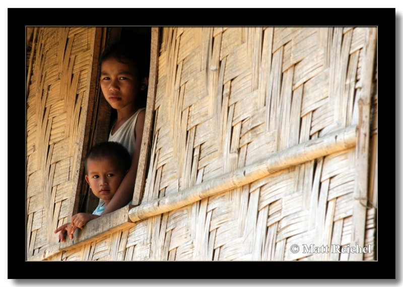 Sister and Brother Peering Out, Oudomxai, Laos