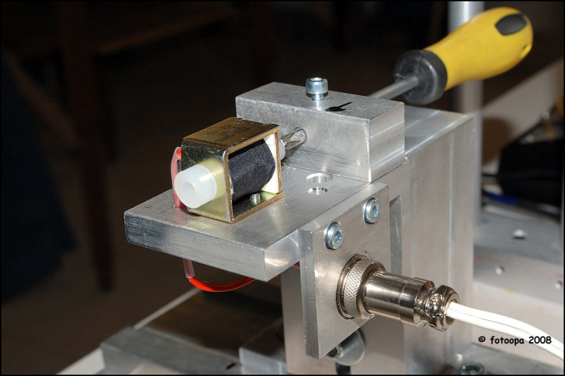 The solenoid-fired projectile.