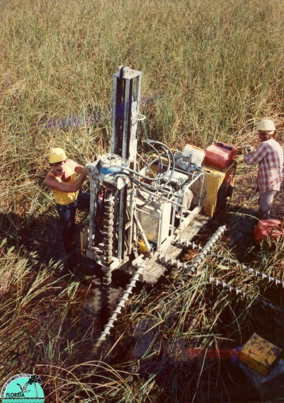 Drilling holes for seismic charges.jpg