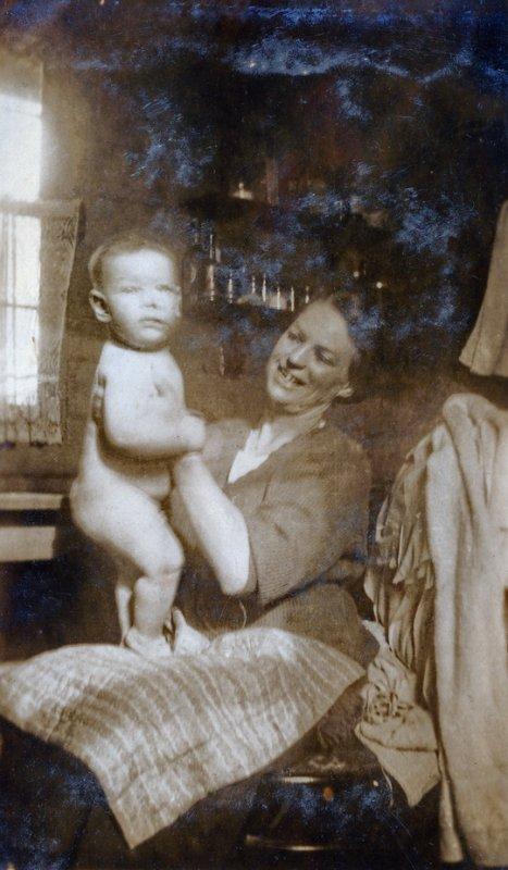 Elsa Fricker my grandmother with my Dad William Norman Fricker ~1923