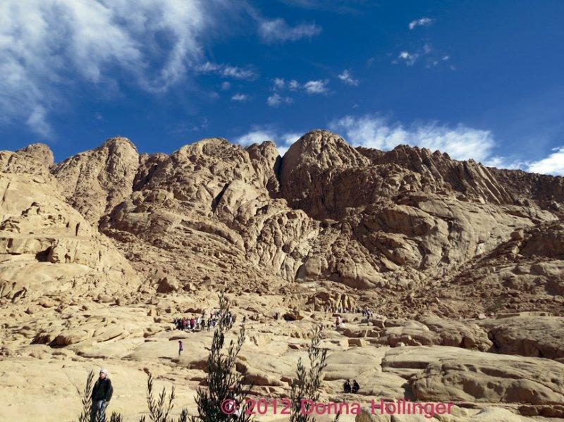 People Climbing Are Dwarfed on Mount Sinai