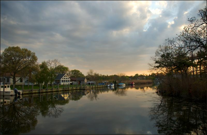 canal in spring at sunset