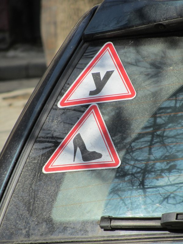 maybe it means Caution: Ukrainian female driver?