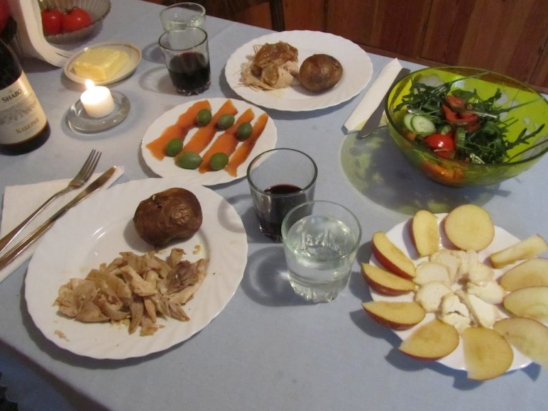 roast chicken with baked potato, smoked salmon, salad, apple and goat cheese