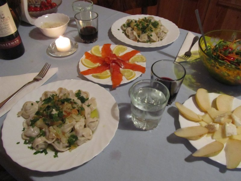 sausage pelmeni with onion topping, smoked trout with lemon, rocket salad, and pears with cheese