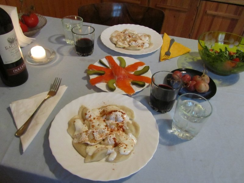 varenyky with cream and paprika, trout and pickle, salad, grapes