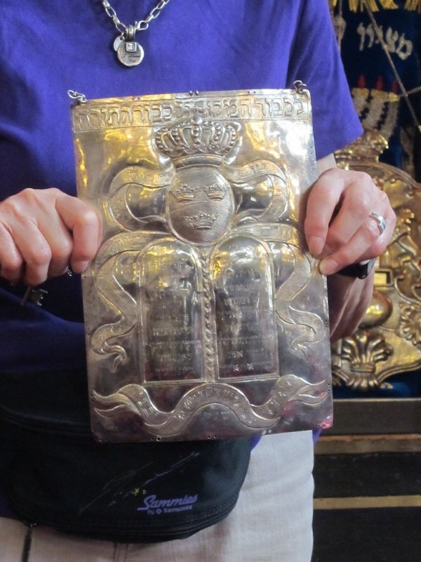 an unusual torah shield, with the emblem of the Swedish monarchy