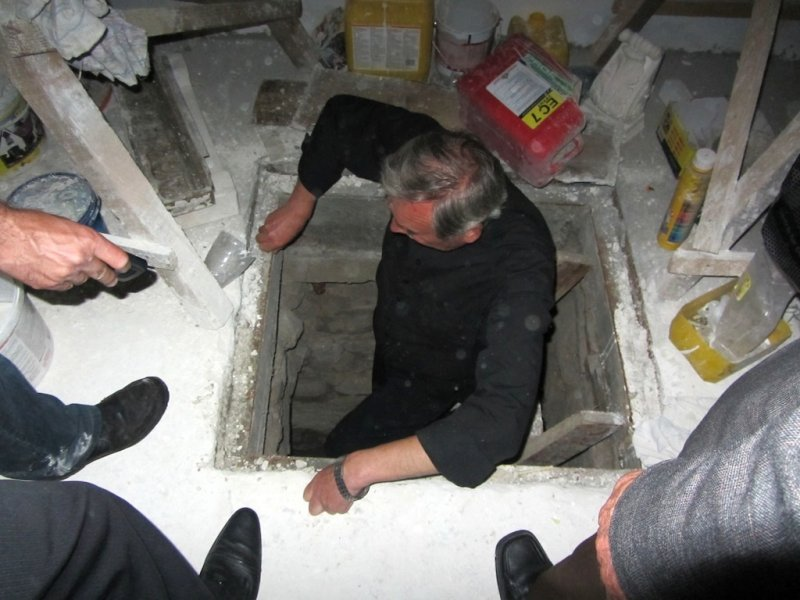 one of the priests takes us down into the cellar