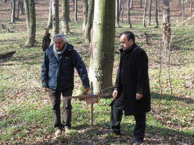 the leaders of this trip pause at a memorial to Italian prisoners of war killed in the same actions