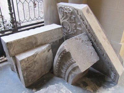 pieces of the stonework are stacked in front and behind