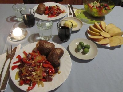 a kolbasa/onion/pepper fry-up with baked potato, olives, salad, and apple