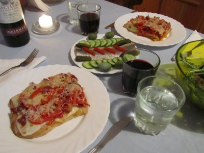 pizza, herring with cucumber & pickle, and salad
