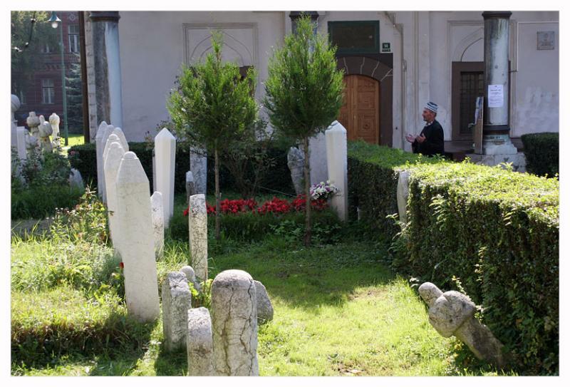 Praying in graveyard