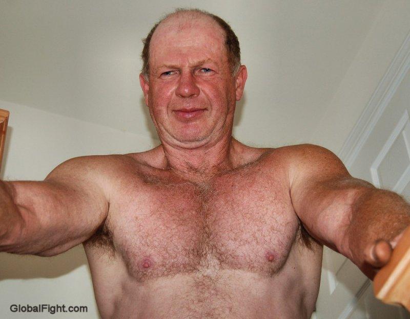 hot grandpa muscular dad flexing big biceps.jpeg