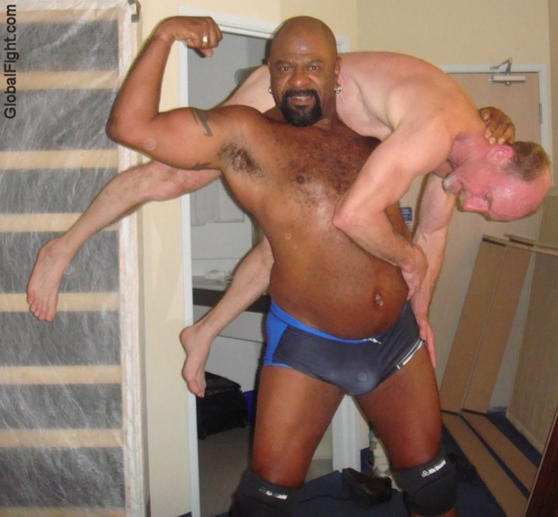 black daddie bear carrying helpless white man pics.jpg