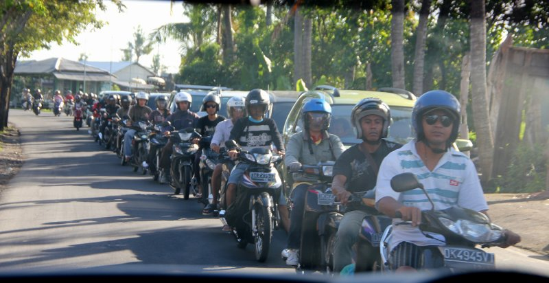 Early morning Bali motorbike traffic at rush hour.