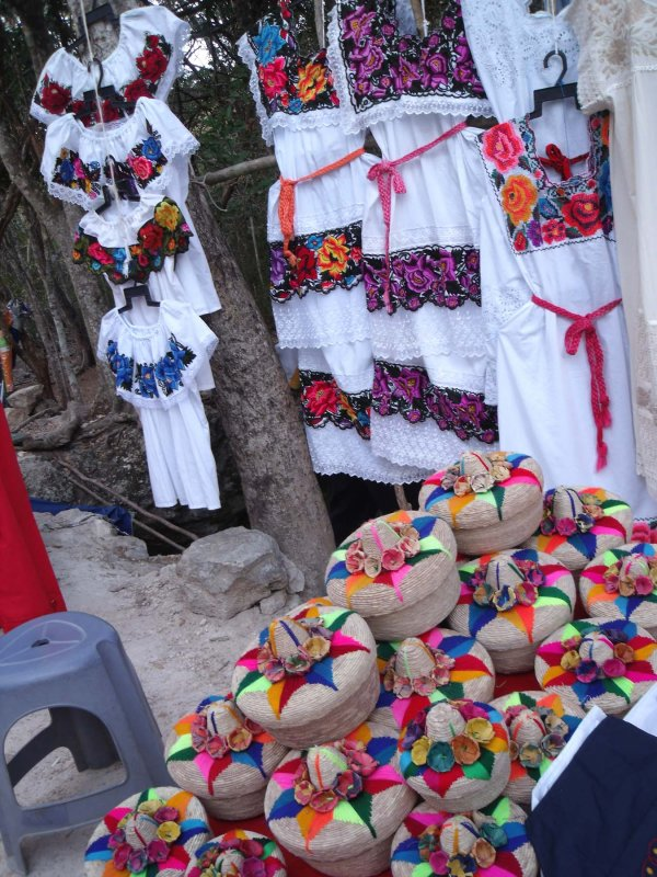 Mexican dresses and baskets for sale.