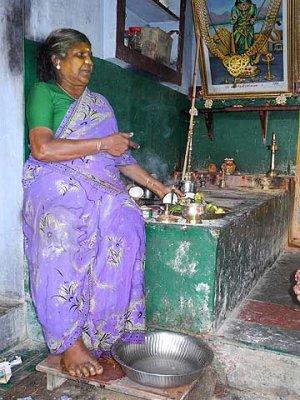 Diviner with offerings for the Gods on her altar. Tirunelveli District, Tamil Nadu.