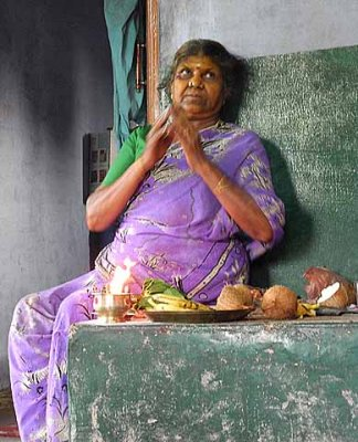 Diviner praying to the Gods, before she starts a ceremony. Tirunelveli District,Tamil Nadu.