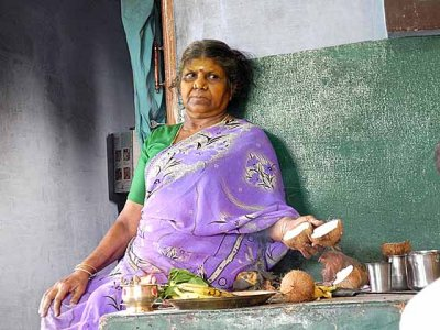 Diviner reading the Gods` answers in the open coconut. Tirunelveli District, Tamil Nadu.