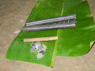 Kani shamanism. 2 kokkaras and a bamboo stick are needed for the ceremony. Tirunelveli District, Tamil Nadu.
