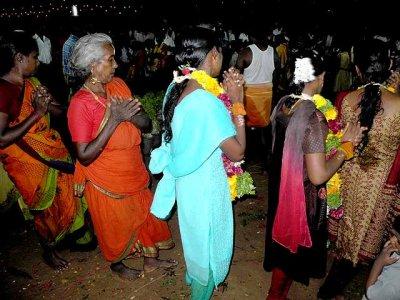 Finally the women dance in a circle around the Mulaipari pots. Mulaipari festival at Koovathupatti, Tamil Nadu.