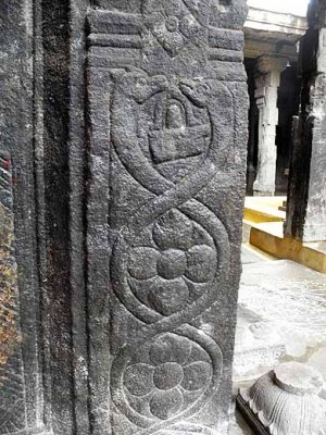 Two snakes facing each other over a Shiva-lingam on a pillar in Ulagamman temple at Tenkasi, Tamil Nadu. http://www.blurb.com/bo