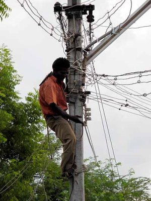 Repair of power cables in Tamil Nadu, India.