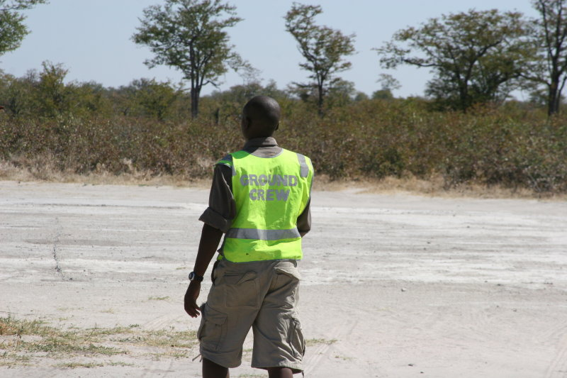 Our guide became the ground crew. He had to chase an elephant from the runway!