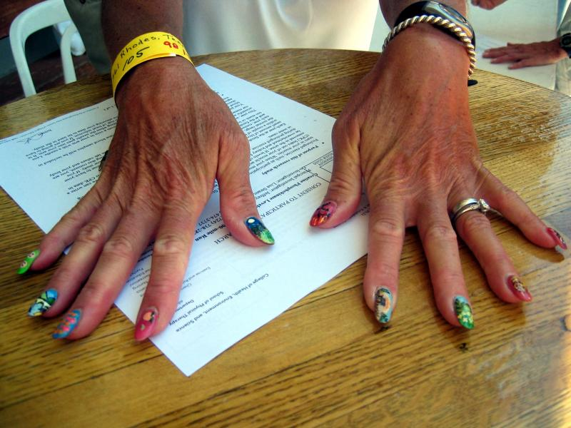 Terri Rhodes paints one nail for each WS aid station