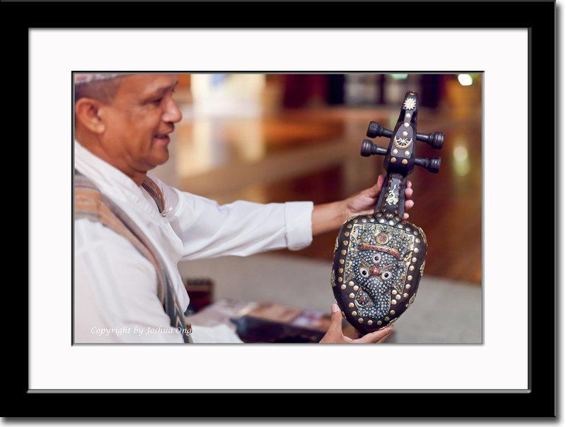 Bharat Nepali Proudly Displays His Sarangi