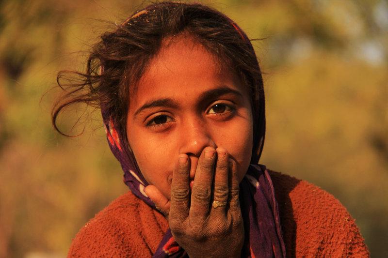 Patan girl with hand.jpg