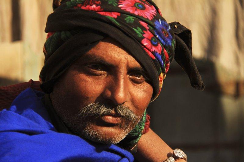 Patan man in blue.jpg