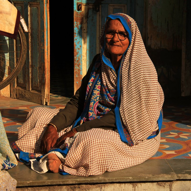 Patan woman sitting square.jpg