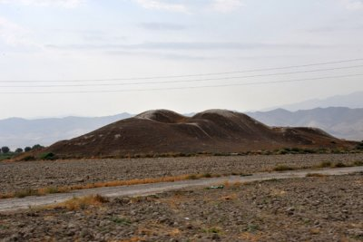 A dirt mound - ruins of an ancient structure along the Silk Road, Anau, Turkmenistan