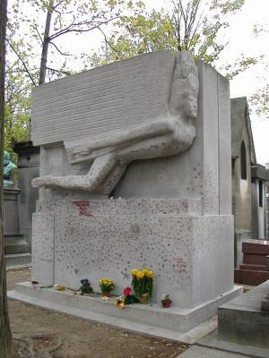 Many kiss Oscar Wildes gravestone with bright red lipstick