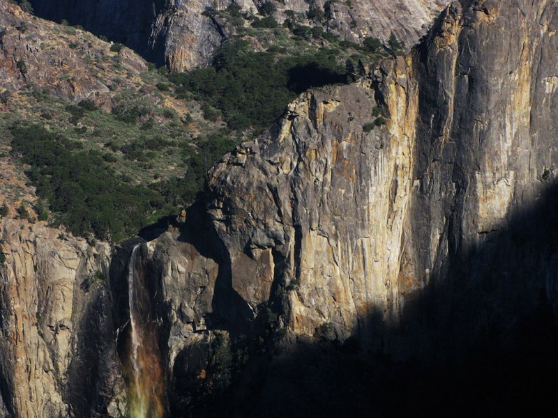 Rainbowd Bridalveil Falls top area w/ trees + looming shadow, from Tunnel View. #1736r2