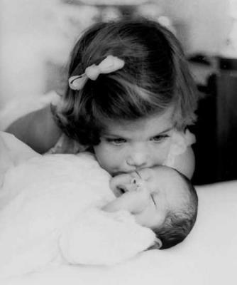 Caroline Kennedy, 3, kissing her baby brother John F. Kennedy Jr. in 1961 in Palm Beach, Florida
