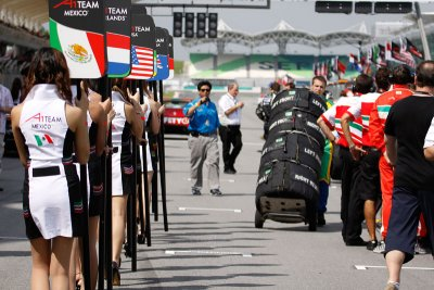 The grid girls parade