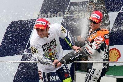 SEPANG, MALAYSIA - OCTOBER 25: Valentino Rossi (left) celebrates his win at the Shell Advanced Malaysian Motorcycle Grand Prix 2