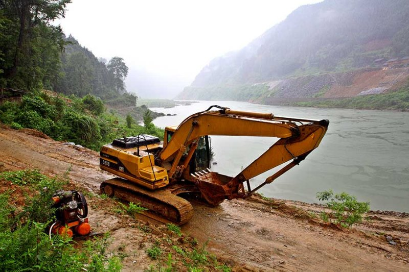 2015 An earth mover used in the construction of the dirt road.