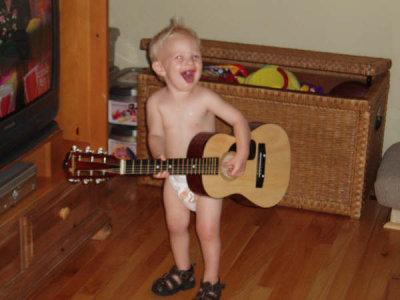 Conner playing the guitar