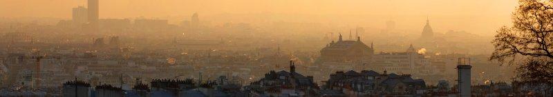 Paris, buried in orange winter evening