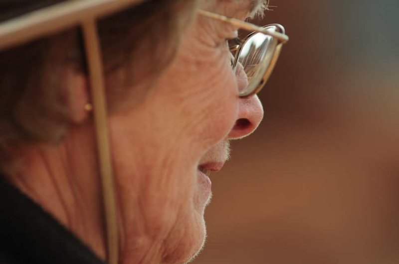 Docent, With Wupatki Ruins Visible in her Glasses