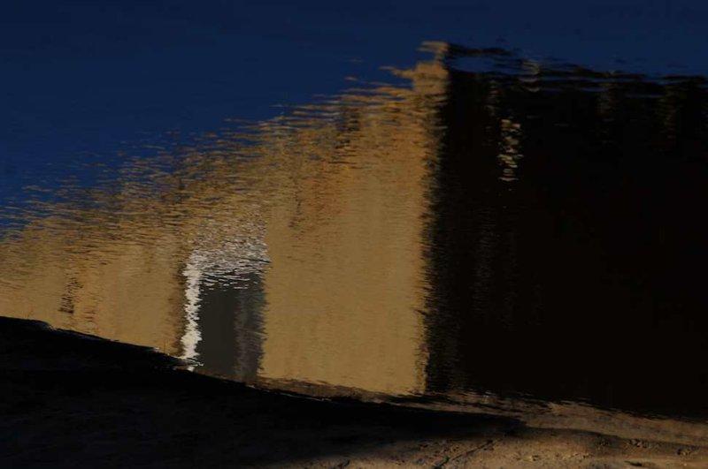 Building Reflection in a Cistern, Acoma Pueblo, New Mexico